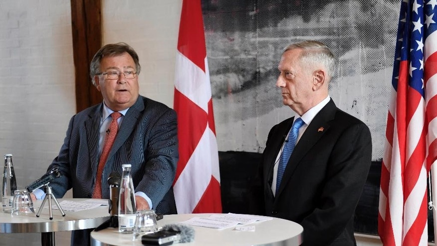 US Secretary of Defense Jim Mattis, right, stands with Danish Defense Minister Claus Hjort Frederiksen,  during a press conference, in Copenhagen, Denmark, Tuesday, May 9, 2017. Mattis said he had open and useful discussions with Turkish officials Tuesday, and said the two countries are working out differences over America's continuing support for Syria Kurds as the fight against Islamic State militants moves closer to group's headquarters in Raqqa. (Stine Tidsvilde/Ritzau Foto via AP)