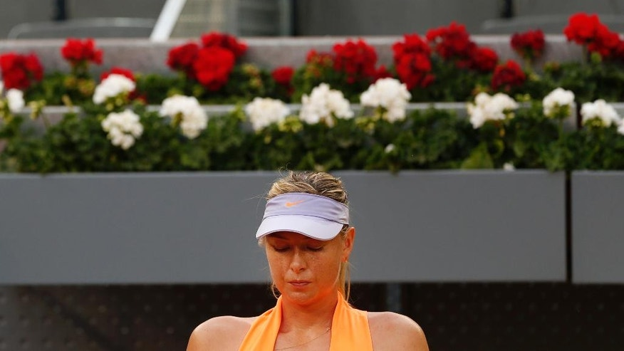 Maria Sharapova from Russia sits in a break during her Madrid Open tennis tournament match against Eugenie Bouchard from Canada in Madrid, Spain, Monday, May 8, 2017. Bouchard won 7-5, 2-6 and 6-4. (AP Photo/Francisco Seco)