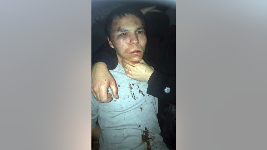 FILE-In this Monday, Jan. 16, 2017 file photo, Abdulkadir Masharipov, an Uzbek citizen, suspected of the New Year's day attack at a nightclub, is pictured following his arrest in Istanbul. Turkey's state-run news agency said on Tuesday, May 9, 2017, prosecutors in Istanbul are demanding 40 consecutive life sentences for the man who attacked the nightclub, killing 39 people. Masharipov, was caught on Jan. 16 after evading police for more than two weeks. (AP Photo/File)
