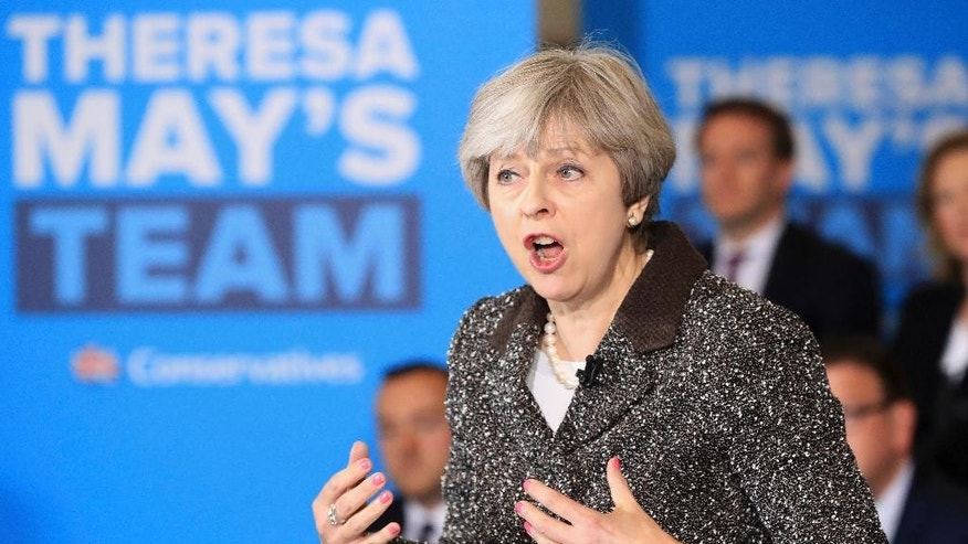 Prime Minister Theresa May speaks during a campaign visit to York Barbican, England, Tuesday, May 9, 2017. (Danny Lawson/PA via AP)