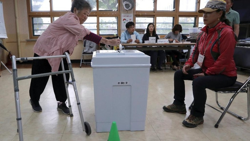 A woman casts her ballot for presidential election at a local polling station in Seoul, South Korea, Tuesday, May 9, 2017. South Koreans voted Tuesday for a new president, with victory widely predicted for a liberal candidate who has pledged to improve ties with North Korea, re-examine a contentious U.S. missile defense shield and push sweeping economic changes. (AP Photo/Lee Jin-man)
