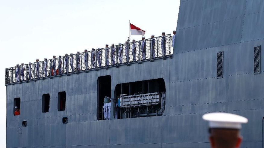 An Indonesian flag flutters from the rear deck of the new Philippine Navy ship named BRP Davao del Sur as it docks at Manila's South Harbor Wednesday, May 10, 2017 in Manila, Philippines. The Philippine navy welcomed Wednesday the second Indonesian-made amphibious landing dock as part of the military's modernization program. (AP Photo/Bullit Marquez)