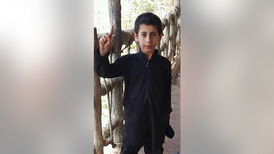 "This undated militant photo shows Yazidi boy Akram Rasho Khalaf, while in Islamic State militant captivity in Raqqa, Syria. Now 10 years old, he recalls, ""They were telling us, 'When you grow up, you will blow yourself up, God willing,' and some of the kids said, 'We will not blow ourselves up,'"" Akram said. ""Then they asked us, 'Which one of you wants to go to paradise?' And the kids didn't know what to say."" (militant photo via AP)"