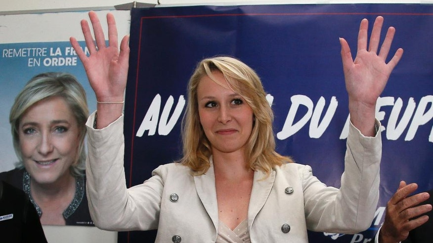 "FILE - In this Tuesday, April 11, 2017 file photo, Far right National Front party regional leader for southeastern France Marion Marechal-Le Pen waves during a press conference in Bayonne, southwestern France. The niece of defeated far-right French presidential candidate Marine Le Pen announced Tuesday, May 9 that she's leaving political life, at least temporarily, citing ""personal and political reasons."" Marion Marechal-Le Pen had been seen as a rising star of the nationalist and anti-immigration National Front party. She is one of two lawmakers in the outgoing lower house of parliament affiliated with the party. (AP Photo/Bob Edme, file)"