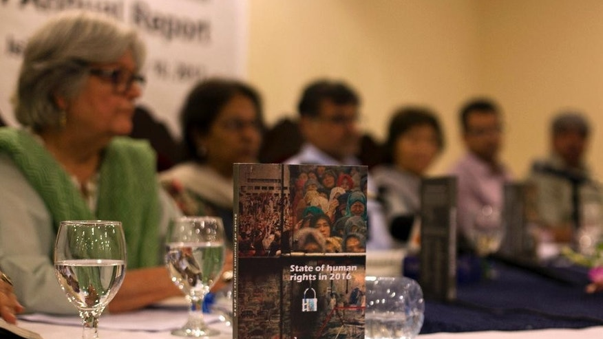 The Human Rights Commission of Pakistan presents the 2016 annual human rights report, in Islamabad, Pakistan, Wednesday, May 10, 2017.  The report released Wednesday by the independent group, offered a mixed report card in its annual look at the state of human rights in Pakistan, welcoming the enactment of new laws to protect women but decrying an uptick in religiously motivated vigilantism. The report said the country's use of capital punishment ranked among the highest in the world, while its literacy rate was among the lowest. (AP Photo/B.K. Bangash)