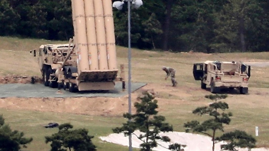 FILE - In this May 2, 2017, file photo, a U.S. missile defense system called Terminal High Altitude Area Defense, or THAAD, is installed at a golf course in Seongju, South Korea. Former President Park Geun-hye's decision to allow the United States to base the state-of-the-art missile defense system in South Korea's territory to cope with North Korean nuclear threats is a major irritant. There's widespread opposition in South Korea to the THAAD deployment and loud protests from China, which also sees the system as a security threat. But challenging Washington over THAAD might be difficult for new President Moon Jae-in. (Kim Jun-beom/Yonhap via AP, File)