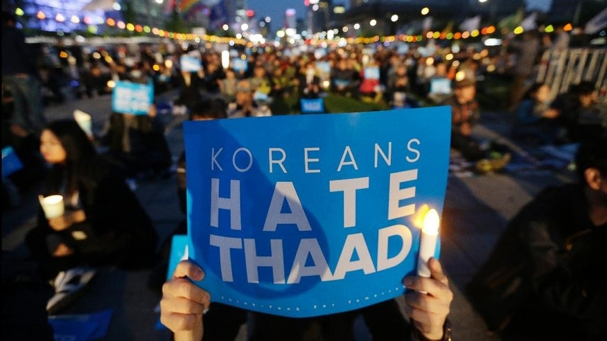 FILE - In this April 29, 201, file photo, South Korean protesters stage a rally to oppose a plan to deploy the advanced U.S. missile defense system called Terminal High Altitude Area Defense, or THAAD, near U.S. Embassy in Seoul, South Korea. Former President Park Geun-hye's decision to allow the United States to base the state-of-the-art missile defense system in South Korea's territory to cope with North Korean nuclear threats is a major irritant. There's widespread opposition in South Korea to the THAAD deployment and loud protests from China, which also sees the system as a security threat. But challenging Washington over THAAD might be difficult for new President Moon Jae-in.  (AP Photo/Ahn Young-joon, File)