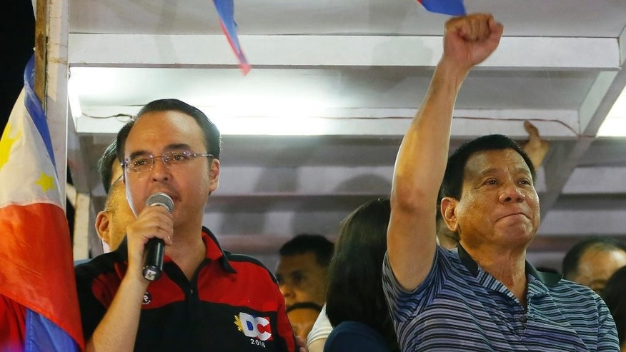 FILE - This April 22, 2016, file photo shows Sen. Alan Peter Cayetano, left, then the running mate of front-running presidential candidate Mayor Rodrigo Duterte, right, during a campaign sortie at Silang township, Cavite province south of Manila, Philippines. Duterte told reporters on Wednesday, May 10, 2017, before flying to Cambodia to attend the World Economic Forum on ASEAN that he had appointed Cayetano to the new position as foreign secretary. Cayetano had staunchly defended Duterte's bloody crackdown on illegal drugs. (AP Photo/Bullit Marquez, File)