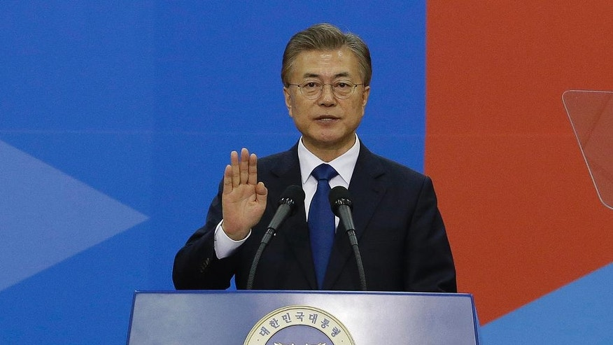 South Korean President Moon Jae-in takes an oath during his inauguration ceremony at the National Assembly in Seoul, Wednesday, May 10, 2017. (AP Photo/Ahn Young-joon. Pool)