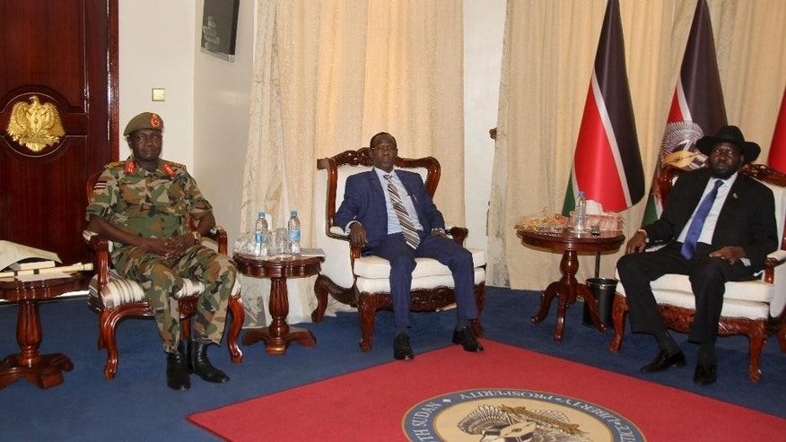 South Sudan's newly appointed army chief of staff Lt. Gen. James Ajongo Mawut, left, meets with Vice-President James Wani Igga, center, and President Salva Kiir, right, at the presidential palace in Juba, South Sudan Wednesday, May 10, 2017. Former army chief of staff Paul Malong, who had been proposed for U.N. sanctions and accused of directing last year's fighting in the capital that left hundreds dead, was removed from his post on Tuesday. (AP Photo/Samir Bol)