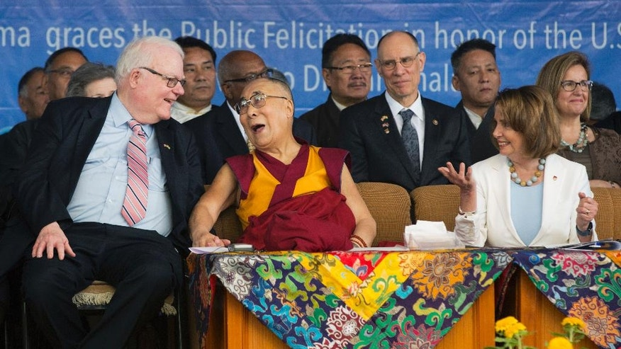 "Tibetan spiritual leader Dalai Lama laughs with Republican Jim Sensenbrenner as the Minority Leader in the U.S. House of Representatives Nancy Pelosi, right, looks on at the Tsuglagkhang temple in Dharmsala, India, Wednesday, May 10, 2017. A group from US Congress is taking aim at one of China's sore spots, Tibet, during a meeting in India with the Tibetan Buddhist spiritual leader. Pelosi said Wednesday that China was using ""brutal tactics"" and economic leverage to crush Tibetan calls for autonomy. (AP Photo/Ashwini Bhatia)"