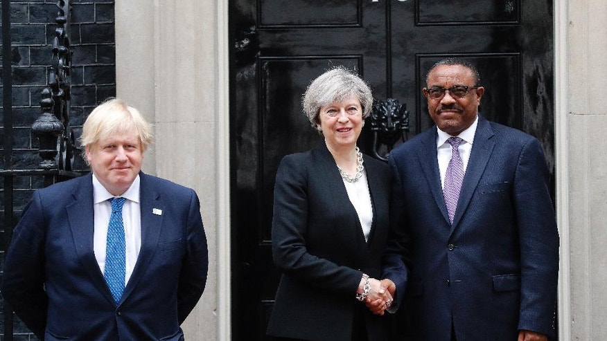 Britain's Prime Minister Theresa May, center, meets with Ethiopian President Mulatu Teshome, right, and Britain's Secretary of State for Foreign Affairs Boris Johnson, left, ahead of the Somalia Conference at No 10 Downing Street in London, Thursday, May 11, 2017. (AP Photo/Frank Augstein)