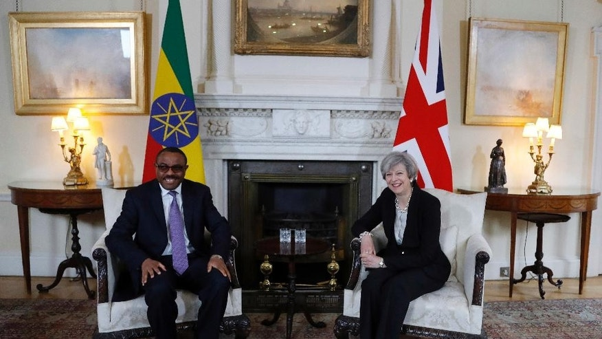 Britain's Prime Minister Theresa May meets with Ethiopian President Mulatu Teshome ahead of the Somalia Conference at No 10 Downing Street in London, Thursday, May 11, 2017. (AP Photo/Frank Augstein, Pool)