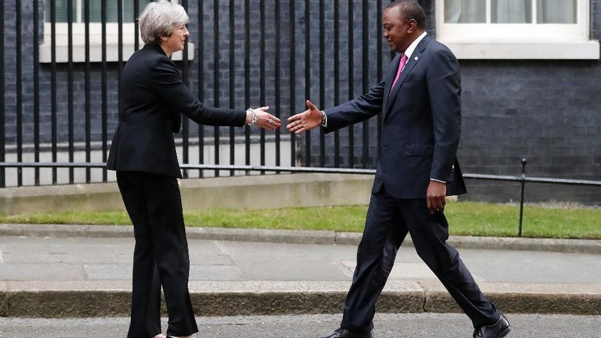 Britain's Prime Minister Theresa May meets with President of Kenya Uhuru Kenyatta ahead of the Somalia Conference at No 10 Downing Street in London, Thursday, May 11, 2017. (AP Photo/Frank Augstein)