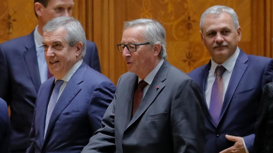 "The European Commission's President Jean-Claude Juncker, center, walks with the heads of Romania's parliament chambers Calin Popescu Tariceanu, left, and Liviu Dragnea before an anniversary session marking 10 years since Romania joined the European Union in Bucharest, Romania, Thursday, May 11, 2017. The European Commission's president said Thursday that Romania's membership in the European Union had brought ""peace and stability to our continent"" adding there should not be a second-rate Europe. (AP Photo/Vadim Ghirda)"