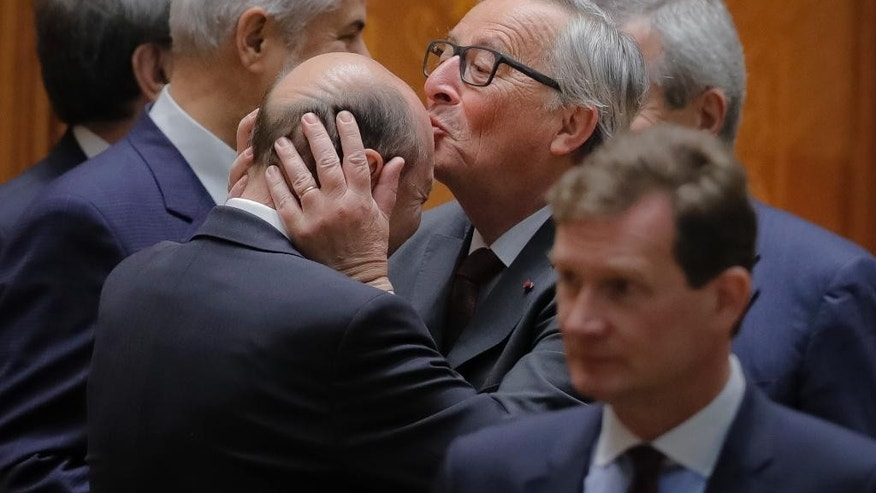 "The European Commission's President Jean-Claude Juncker, right, kisses former Romanian President Traian Basescu's forehead before an anniversary session of parliament marking 10 years since Romania joined the European Union in Bucharest, Romania, Thursday, May 11, 2017. The European Commission's president said Thursday that Romania's membership in the European Union had brought ""peace and stability to our continent"" adding there should not be a second-rate Europe.(AP Photo/Vadim Ghirda)"