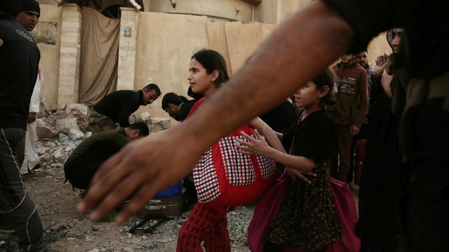 Children flee as Iraqi special forces search civilians during heavy fighting between Islamic State militants and Iraqi special forces in Mosul, Iraq, Wednesday, May 10, 2017. (AP Photo/Maya Alleruzzo)