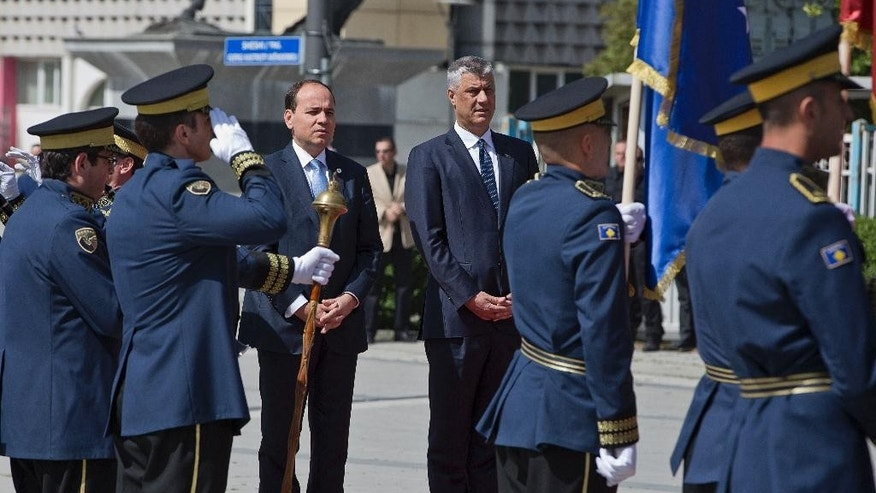 Albania's President Bujar Nishani, left, and Kosovo's President Hashim Thaci review an honor guard during a welcome ceremony in capital Pristina, Kosovo, on Thursday, May 11, 2017. (AP Photo/Visar Kryeziu)