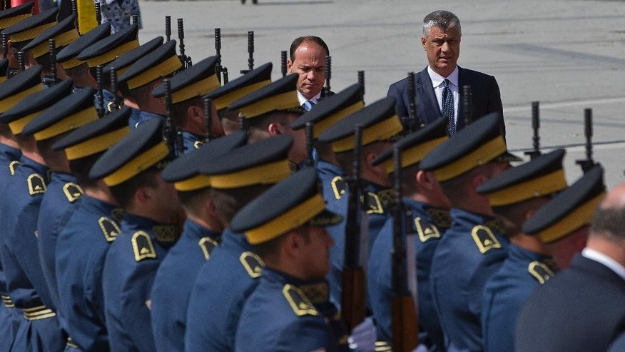 Kosovo's President Hashim Thaci, right, and Albania's President Bujar Nishani review an honor guard during a welcome ceremony in capital Pristina, Kosovo on Thursday, May 11, 2017 during his visit to Kosovo. (AP Photo/Visar Kryeziu)