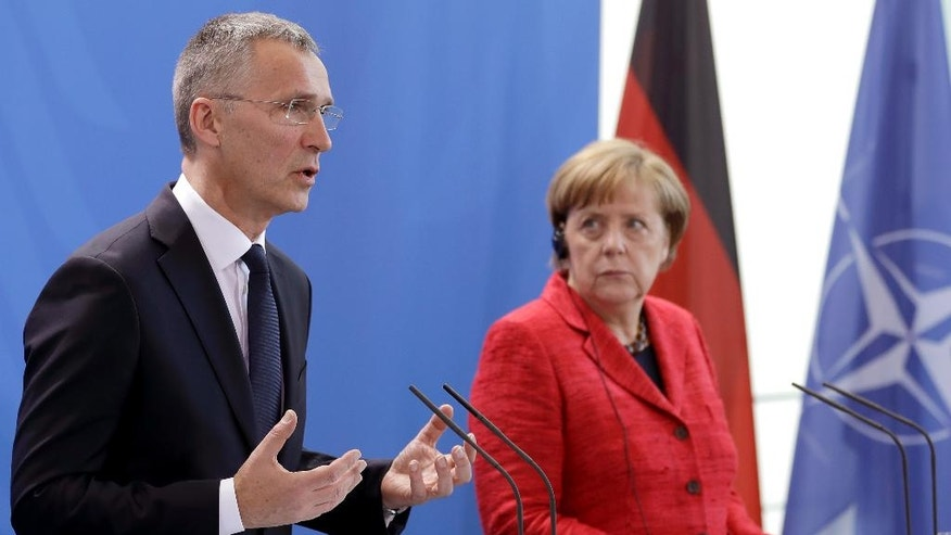 German Chancellor Angela Merkel, right, and NATO Secretary General Jens Stoltenberg, left, address the media during a joint press conference as part of a meeting at the chancellery in Berlin, Germany, Thursday, May 11, 2017. (AP Photo/Michael Sohn)
