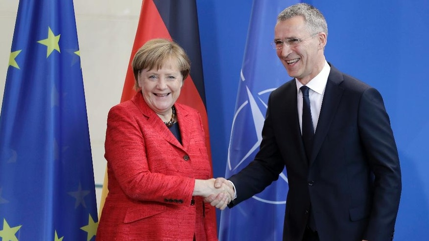 German Chancellor Angela Merkel, left, and NATO Secretary General Jens Stoltenberg, right, shake hands after a joint press conference as part of a meeting at the chancellery in Berlin, Germany, Thursday, May 11, 2017. (AP Photo/Michael Sohn)