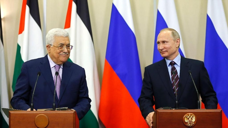 Russian President Vladimir Putin, right, and Palestinian President Mahmoud Abbas attend a joint press conference at the Bocharov Ruchei residence in the Black Sea resort of Sochi, Russia, Thursday, May 11, 2017. (Yuri Kochetkov/Pool photo via AP)