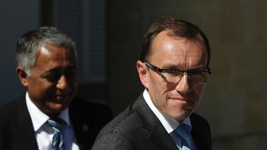 "U.N. Special Advisor of the Secretary-General Espen Barth Eide leaves the presidential palace after a meeting with Cypriot president Nicos Anastasiades in Nicosia, Cyprus, Thursday, May 11, 2017. Eide  says ongoing talks aimed at reunifying ethnically Cyprus are at risk of collapse because of a possible ""international crisis"" revolving around the east Mediterranean island. (AP Photo/Petros Karadjias)"