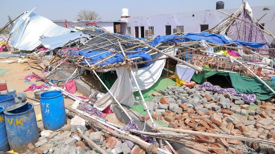 A view of the debris after a building wall collapsed onto guests at a wedding in India's Rajasthan state. At least 24 people were killed.