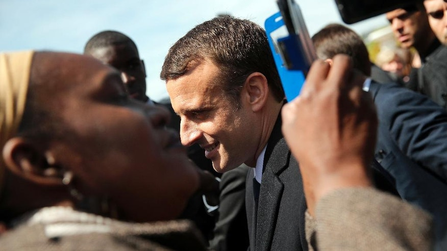 French President-elect Emmanuel Macron poses with supporters after a ceremony commemorating the abolition of slavery, in Paris, Wednesday, May 10, 2017. (AP Photo/Christophe Ena)
