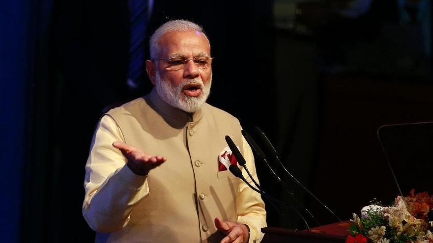 Indian Prime Minister Narendra Modi addresses the gathering at the UN celebration of Vesak ceremony or Buddha Purnima in Colombo, Sri Lanka, Friday, May 12, 2017. During his two-day visit Modi participated in the United Nations celebration of Vesak or the day of birth, enlightenment and death of the Buddha. He also inaugurated a modern hospital for the benefit of tea plantation workers , ancestors of Indian laborers brought by the British from the 18th century. (AP Photo/Eranga Jayawardena)