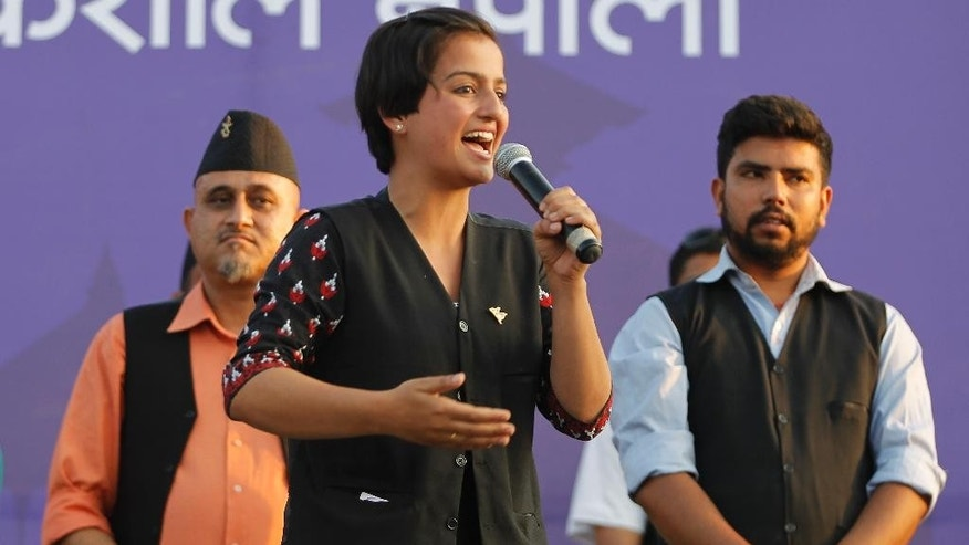 In this May 10, 2017 photo, Kathmandu's mayoral candidate Ranju Darshana, from Bibeksheel Nepali party, gives a speech during a campaign event in Kathmandu. Much has changed since Nepal last held local elections 20 years ago _ the Himalayan country's 240-year monarchy was abolished, federal democracy was introduced and political wrangling took center stage. Earthquakes ravaged the country. A Maoist insurgency left thousands dead. And widespread poverty ensured daily life for many remained a struggle if not a misery. Through it all, Nepal's 29 million citizens have had only government-appointed bureaucrats to look to for answers or help with settling local disputes. Many voters said they were excited for the chance this weekend to choose local representatives for the first time since 1997.(AP Photo/Niranjan Shrestha)
