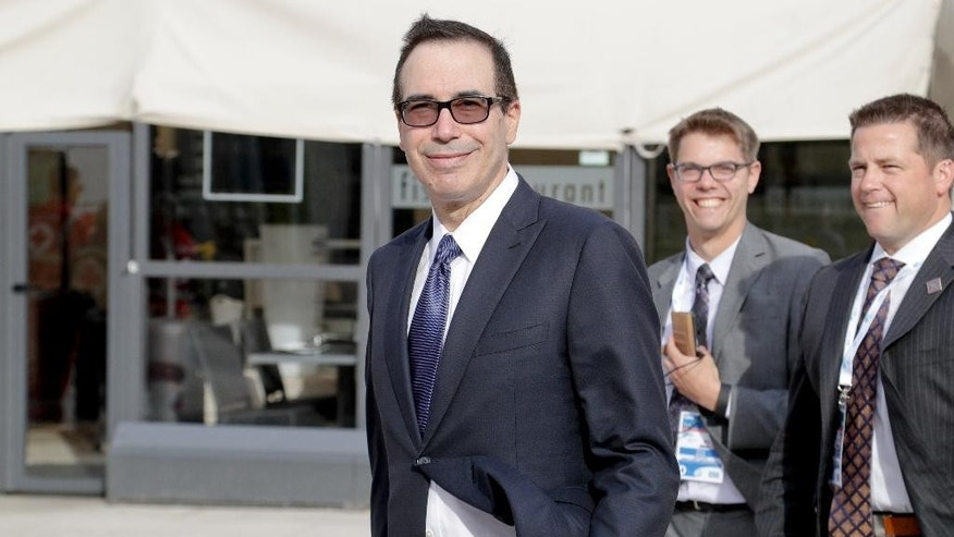 United States Treasury Secretary Steven Mnuchin, center, smiles as he takes a walk in the Puglian town of Bari, southern Italy, which is hosting a G7 of Finance Ministers and Central Bank Governors meeting, Thursday, May 11, 2017. (AP Photo/Andrew Medichini)