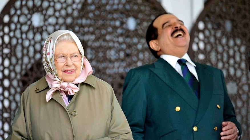 The King of Bahrain Hamad bin Isa Al Khalifa, laughs as he stands with Britain's Queen Elizabeth II  as they attend  the Royal Windsor Horse Show, which is held in the grounds of Windsor Castle in Windsor England  Friday May 12, 2017. (Nick Ansell/PA via AP)