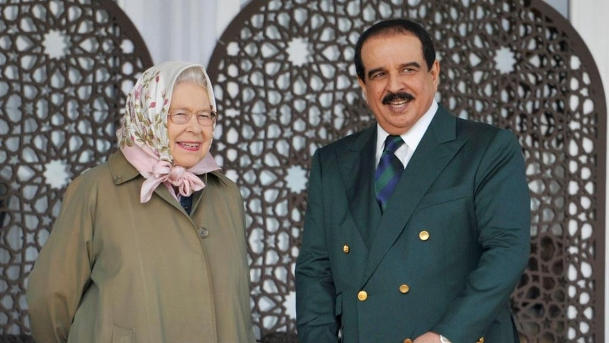 Britain's Queen Elizabeth II and the King of Bahrain Hamad bin Isa Al Khalifa attending  the Royal Windsor Horse Show, which is held in the grounds of Windsor Castle in Windsor England  Friday May 12, 2017. (Nick Ansell/PA via AP)