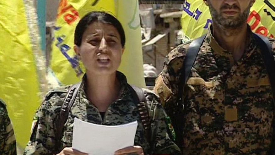 This frame grab from video provided by The Syrian Democratic Forces a U.S.-backed Syrian Kurdish forces outlet that is consistent with independent AP reporting shows Jihan Sheikh Ahmed Spokeswoman for the Syrian Democratic Forces reads a statement aft