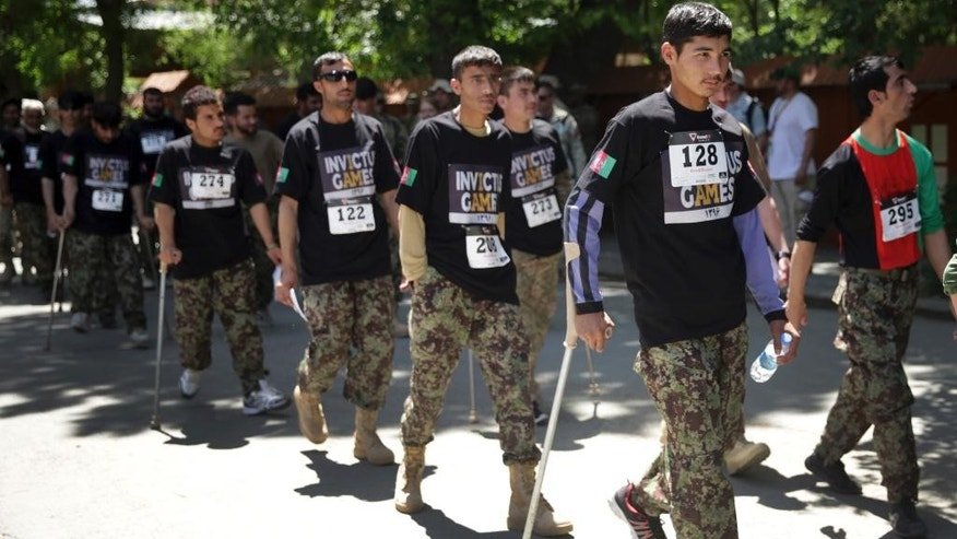 "Wounded warriors from Afghanistan's National Security Forces arrive at the Resolute Support Headquarters to participate in ""Invictus Games"", in Kabul, Afghanistan, Saturday, May 13 , 2017. Wounded warriors from Afghanistan's National Security Forces are competing for a spot in the Invictus Games to be held in Canada in September. (AP Photos/Massoud Hossaini)"