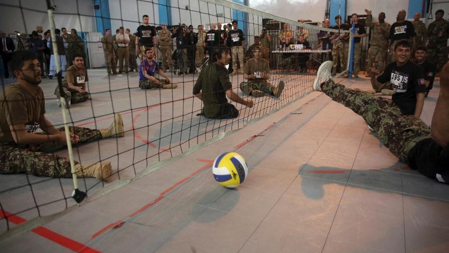 "Wounded warriors from Afghanistan's National Security Forces compete during a volleyball match for ""Invictus Games"" at the Resolute Support headquarters, in Kabul, Afghanistan, Saturday, May 13 , 2017. Wounded warriors from Afghanistan's National Security Forces are competing for a spot in the Invictus Games to be held in Canada in September. (AP Photos/Massoud Hossaini)"