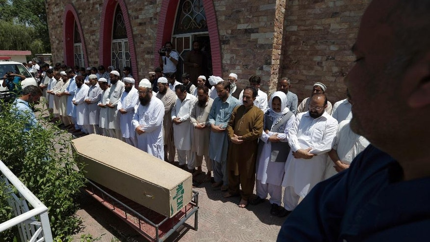 People offer funeral prayers of a victim of Friday's suicide attack in southwest Baluchistan province, in Islamabad, Pakistan, Saturday, May 13, 2017. The Islamic State group said it carried out the brazen suicide attack on a Pakistani lawmaker that killed 25 people despite a protracted crackdown on the assortment of militant groups operating in Pakistan. (AP Photo/Anjum Naveed)