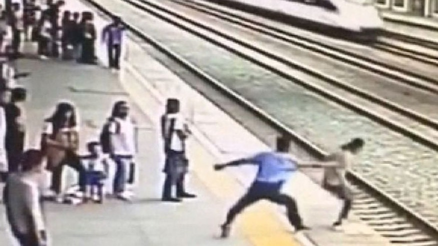 The brave rail worker grabbed the woman's arm as she neared the platform edge