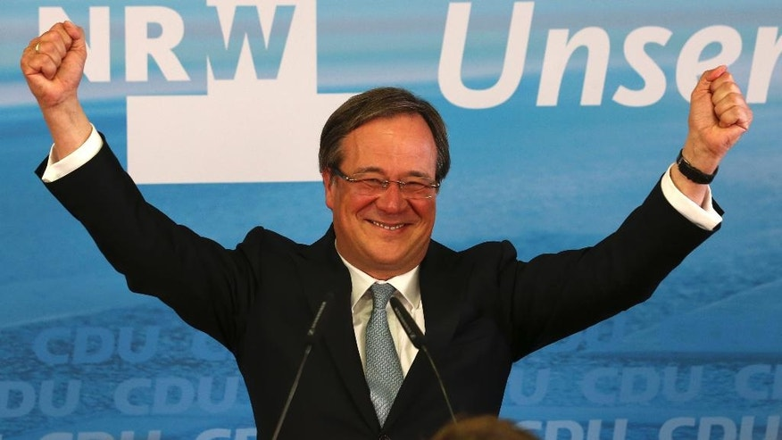 Armin Laschet, top candidate of the Christian Democratic Union, celebrates after the state election in the western German state of Northrhine-Westphalia in Duesseldorf, Germany, Sunday, May 14, 2017. First exit polls predict significant gains for Angela Merkel's Christian Democratic party. (AP Photo/Michael Probst)