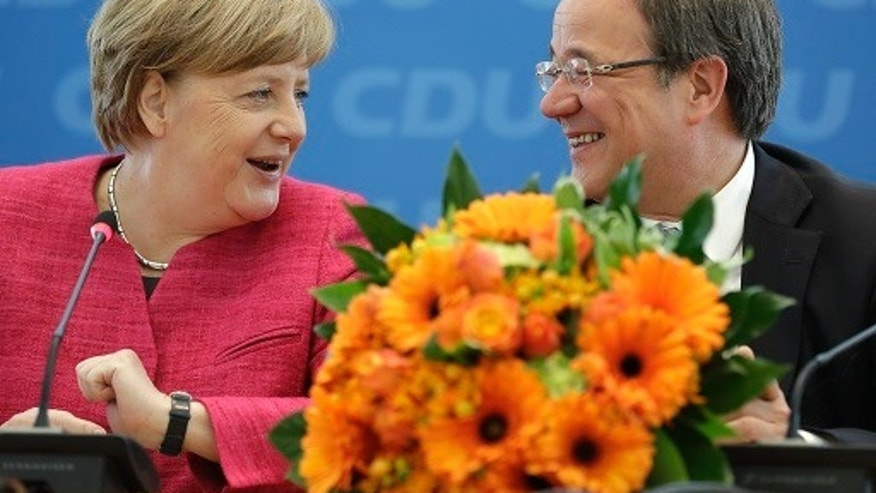 Angela Merkel, German Chancellor and chairwoman of the German Christian Democratic Party (CDU), is sitting with CDU top candidate for the state elections in North Rhine-Westphalia, Armin Laschet, in Berlin, Germany, on Monday, May 15, 2017.