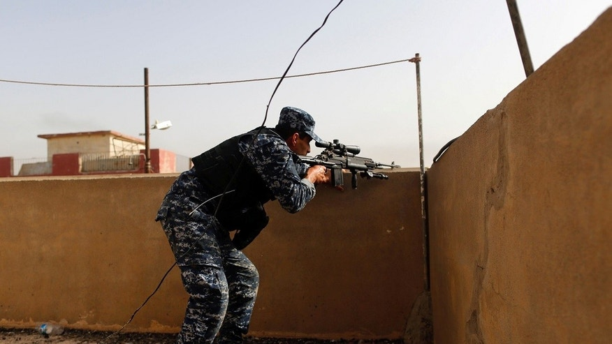 "The fight to retake Mosul from the Islamic State (IS) group is nearing its ""final stages,"" a senior U.S. official said Monday. A Federal police member is seen Monday in Mosul."