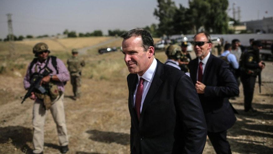 "Brett McGurk, center, the special presidential envoy for the global coalition against the Islamic State visits water treatment plant south of Mosul on Monday, May 15, 2017.  The senior U.S. official says the fight to retake Mosul from the Islamic State group is approaching its ""final stages."" (AP Photo/Bram Janssen)"