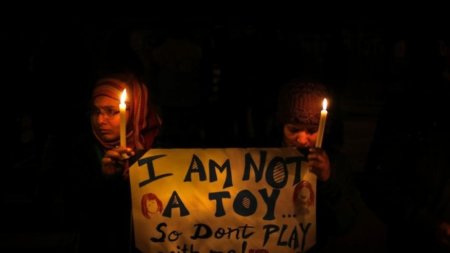 FILE - In this Dec. 30, 2012 photo, Indians hold a candle light vigil to mourn the death of a gang rape victim as urge the government to make several key reforms to ensure safety of women, in New Delhi, India. (AP Photo/ Saurabh Das, File)