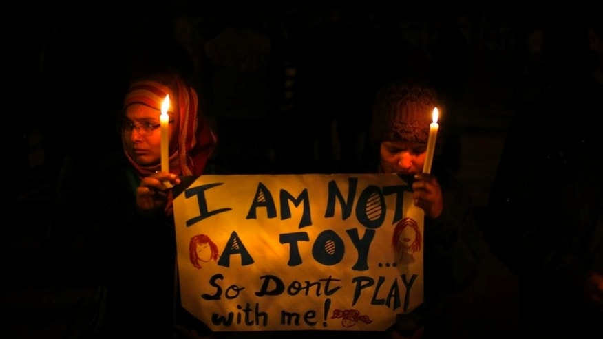 In this Dec. 30, 2012 photo, Indians hold a candle light vigil to mourn the death of a gang rape victim as urge the government to make several key reforms to ensure safety of women, in New Delhi, India.