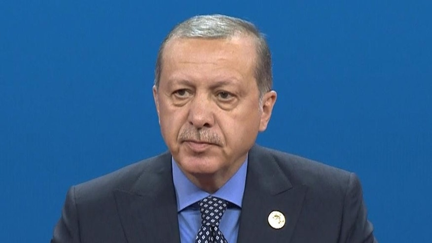 In this photo taken Sunday, May 14, 2017, Turkey's President Recep Tayyip Erdogan speaks during the Belt and Road Forum at the China National Convention Center in Beijing, China. As Erdogan heads to the United States for his first meeting with Donald Trump, Turkish opposition members and human rights defenders are urging the U.S. leader to raise the issue of Turkey's deteriorating human rights and democracy. (Presidency Press Service, Pool photo via AP)