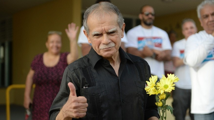 Puerto Rican nationalist Oscar Lopez Rivera gestures as he is released from home confinement after 36 years in federal custody, in San Juan, Puerto Rico, Wednesday, May 17, 2017.