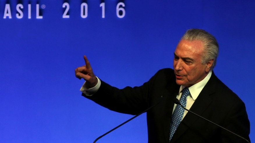 President Temer gestures during a meeting with businessmen in Sao Paulo, Brazil, Dec. 12, 2016.