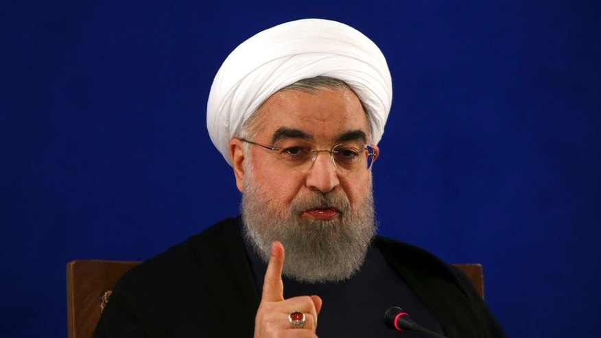 "Iranian President Hassan Rouhani gave a press conference in Tehran, Iran, on Monday where he called relations with the U.S. a ""curvy road.""  (AP Photo/Vahid Salemi)"