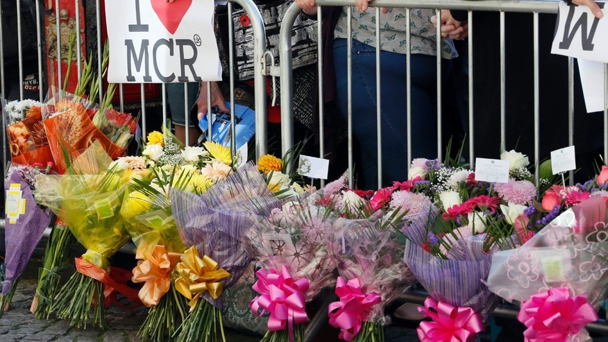 A vigil in Manchester's Albert Square Tuesday after the suicide bombing.